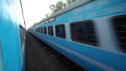 Raigad, India, February 4 2015: Indian passenger train passes by a countryside i Footage