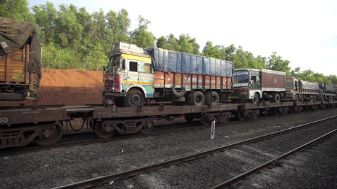 Raigad, India, February 4 2015: Indian Goods Train Passes By A Countryside In Ko stock footage