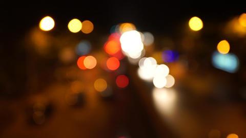 Defocused receding city traffic at night in Mumbai India near (V.T.) CST Station Footage