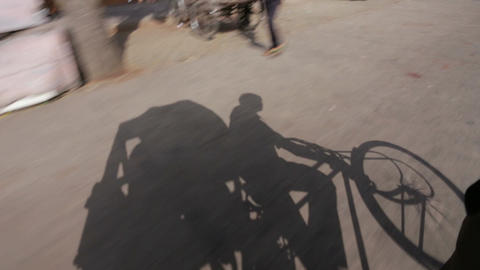 Shadow of cycle rickshaw puller in Jaipur, Rajasthan, India Footage