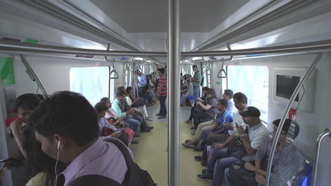 Mumbai, India -March 31, 2015: Mumbai Metro Train Running And Commuters Sitting stock footage
