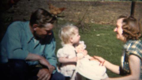 (8mm Vintage) 1952 Dad Mom & Baby Farm Picnic, Chickens In Background. Iowa Footage