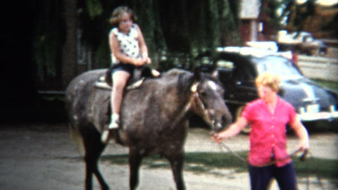 (8mm Vintage) 1954 Girls Riding Horse For 1st Time. Iowa, USA Footage