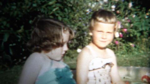 (8mm Vintage) 1954 Girls Playing Outside Small Splash Pools. Iowa, USA Footage