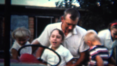 (8mm Vintage) 1954 Dad Letting Daughter Drive Family Farm Tractor. Iowa, USA Footage