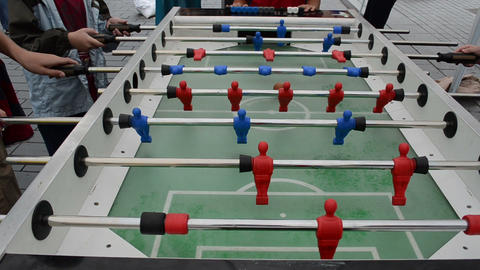 Active Kids Play Table Football In Outdoor Street Event stock footage