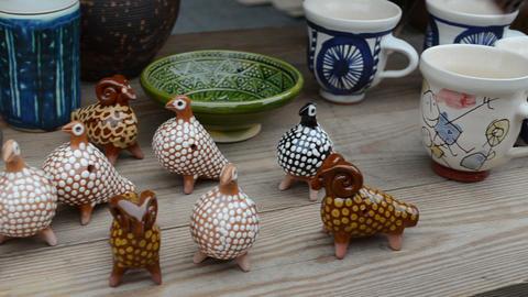 handmade souvenirs cups decors sell street fair market hand Footage