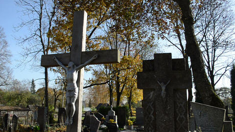 cross crucified jesus stone monuments rural autumn graveyard Footage