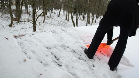man plastic shovel tool clean snow roof winter Live Action
