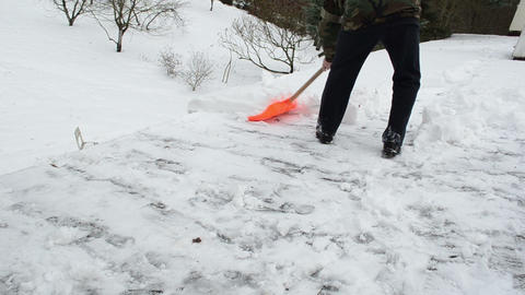 young man shovel tool clean push snow roof winter works Footage