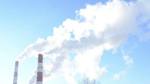 smoke rise industrial boiler house chimney heating city blue sky Footage