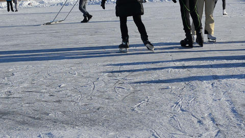 people skate ice outdoor frozen lake pond cold winter day Footage