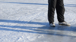 man draw water ice hole pour bucket winter skate site people Footage