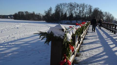 wooden lake bridge christmas decoration people walk winter Footage