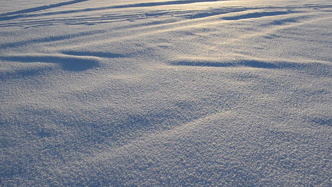 fluffy friable snow footprints frozen lake and beautiful sun sky Footage