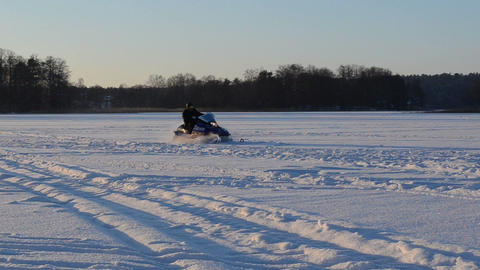 man helmet goggle drive snowmobile transport frozen lake winter Footage