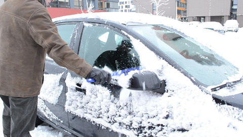 man remove clean snow car window brush winter parking house Footage