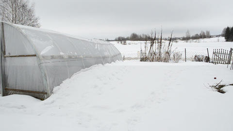 wooden diy homemade greenhouse polythene snow winter garden Footage