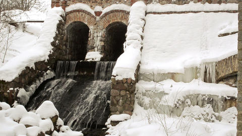 retro river dam covered snow water flow in winter Footage