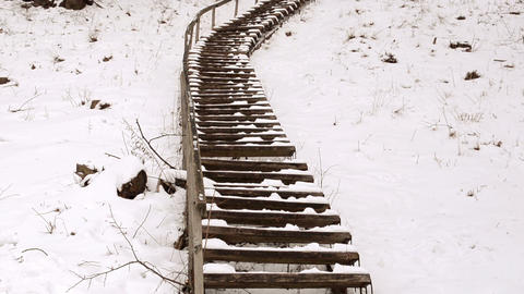 wooden stairs railings huge steep hill cover snow winter park Footage