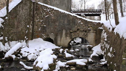 retro water mill building brook flow arch stones snow winter Footage