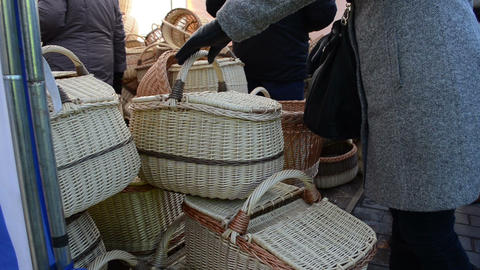 woman at the market choosing wicker basket picnic in the summer Footage
