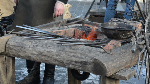 iron steel rod heat glow fire ember prepare blacksmith hammering Footage