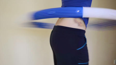 fitness home girl turns hula hoop waist huge bruise bare shows Footage