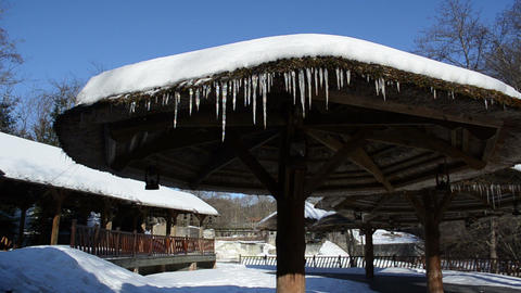 icicle hang straw bower roof snow waterfall cascade river winter Footage