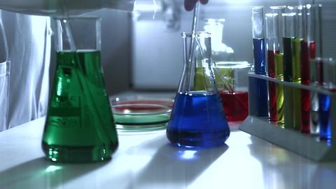Laboratory CSI 191 investigating dolly stylized Stock Video Footage