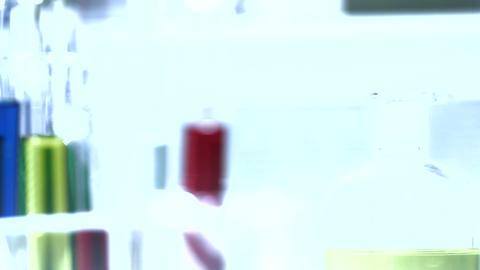 Laboratory CSI 209 investigating dolly stylized Stock Video Footage
