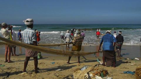 Fishermen pulling a fishing net Stock Video Footage