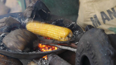 Asian cooks corn Stock Video Footage