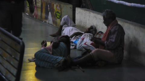 Man sleeping on a street floor Stock Video Footage