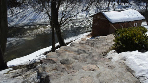 stone stairs outdoor bathhouse roof covered snow winter river Footage
