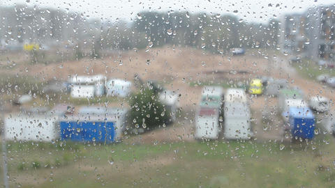 closeup of wet flat house window water drops blur yard outdoor Footage