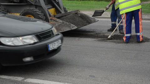 Workers uniform shovels load asphalt remains to small rv bobcat Footage