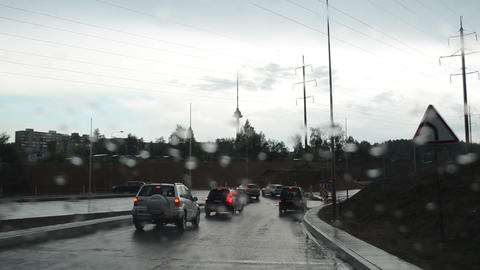 Driving cars on rainy boggy road bad weather conditions Footage