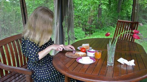 woman in spotted dress prepare sandwich for breakfast Footage