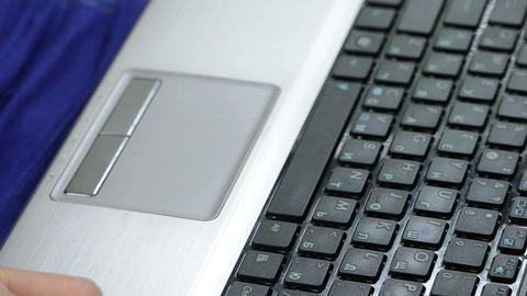 woman hands press laptop keyboard keys and touch touchpad Live Action