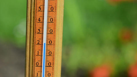 Closeup of thermometer scale temperature rise fast Footage