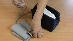Nurse hands put pressure check tool to bag Footage