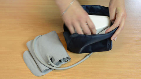 Nurse hand take pressure check tool from bag prepare for work Footage