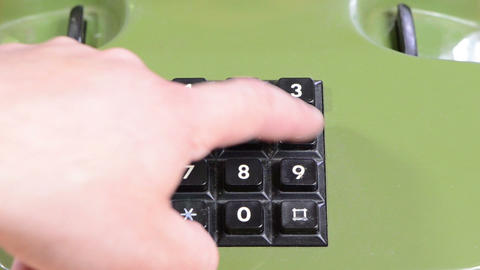 fingers press dial buttons with numbers on old retro telephone Footage