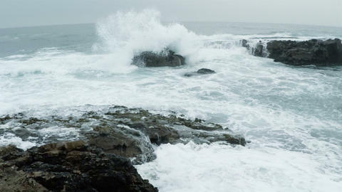 Cold Ocean Surf on the Rocky Shore. Slow Motion Footage