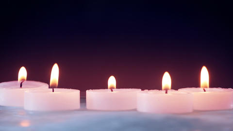 Burning Candles On Ice Seamless Loop stock footage