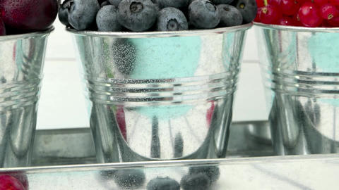 Blueberries in small metal buckets Footage