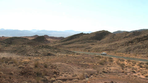 Lone Car Wanders Through Desert stock footage