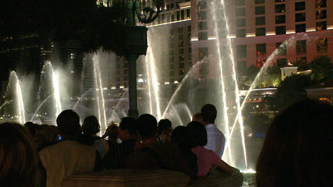 Visitors take photos of Bellagio fountains (2 of 3) Footage