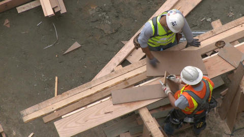 Construction workers take measurements Footage